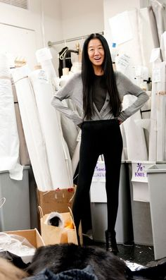 """Read """"The Nightly Routines of 15 Successful Woman"""" and reflect on your evening routine. (Image: Vera Wang, Fashion Designer, standing with her hands on her hips in her work space)"""