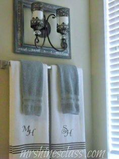 master bathroom with blue towels | home decor, master bath, towels, spa, monogram, sconce
