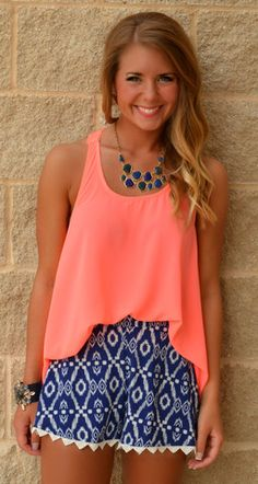 Love this navy with coral. LUNCH WITH FRIENDS AZTEC SHORTS $27.99