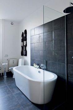 Black and white bathroom at Danish fashion designer Karen Simonsen.  I love the big black tiles.