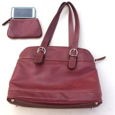 "Laptop Handbag Used maroon laptop bag in excellent condition. Lots of pockets that are great for organization which include a cell phone pocket, card slots, a zipper compartment, lap top compartment that fits a 15"", and a mini bag that clips on and off. Has a couple of scuff marks that come off and has glue residue on strap hardware, which can also be removed. Franklin Covey Bags Laptop Bags"
