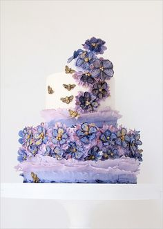 A fanciful cake full of beauty.  You could also snake butterflies up the cake instead of flowers for a nice woodland touch.