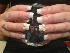 Full set of acrylic nails with white glitter dust on tips ,3D nail art cream bows with swarofski crystal
