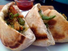 Pita pockets with stir fried veggies and a hint of pesto