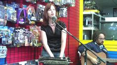 """Marian Call performs her Nerd Anthem """"I'll Still be a Geek After Nobody Thinks it's Chic"""" at Heroes Only Comics and Games in Cheyenne. This was the first time she has ever played a comic book store."""