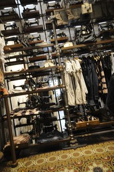 industrial clothing store display - using pipe shelving.....beauty