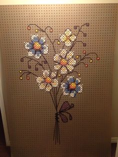 Pegboard cross stitch  Stands 6ft tall and 5.5ft wide Loved how it turned out! Will be using it for a headboard I think :)