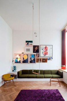 embedded couch, great wall art, vintage chairs and a swing?! this room is inspiring!!