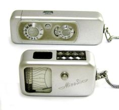 SPY CAMERA AND LIGHT METER: German Minox Wetzlar subminiature model AIII, serial #55 800, c.1954, with 4-element 15mm f/3.5 Complan lens, measuring chain connector, 82 x 28 x 16mm aluminum case. Lot includes a German Minox light meter, circa 1953; camera and meter in matching green slip cases. Sold for $100 in January 2014.