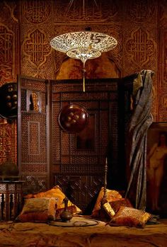 Lumieres de Mariano Fortuny . . . This is just a beautiful room. I love the screen, the walls, the pillows, everything!