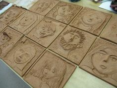 Fifth Grade Students Create Relief Sculpture Self-PortraitsAfter many years of drawing self-portraits, the fifth-graders have been asked to create one more image of themselves in an square tile. The clay tiles show a form of relief sculpture where the. Clay Projects For Kids, Kids Clay, School Art Projects, Auction Projects, Middle School Art, Art School, Sculpture Lessons, Clay Tiles, Ceramics Projects