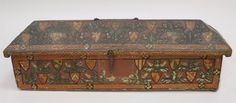 Casket with Oak Leaves and Coats of Arms  Artist/maker unknown, Italian  Geography: Made in Italy, Europe Possibly made in Umbria, Italy, Europe Date: Late 14th century Medium: Wood with low relief and painted decoration on linen; iron hardware Dimensions: 7 x 22 x 6 inches (17.8 x 55.9 x 15.2 cm)