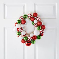 A whimsical ornament wreath adds the perfect touch of cheer to your holiday decor. Use ornaments of your choice for a truly unique look.
