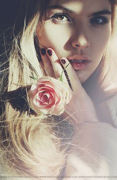 I like the vintage close up of this image as the flower brings our attention to the models face