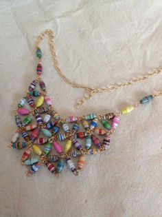 i always find the best jewelry on Etsy. only $52 for hand crafted recycled paper bead necklace with 14k gold filled wire.