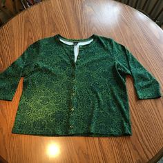 """Rafaella button down 3/4 inch sleeve cardigan Rafaella button down 3/4"""" sleeve cardigan size 1X. Very cute! Looks great with dress pants and with jeans! Rafaella Sweaters Cardigans"""