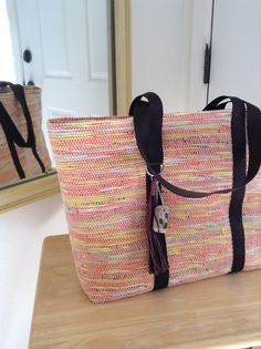 Woven on a rug loom and made from recycled plastic shopping bags: Hand Woven Zippered Plarn Tote - Orange, Yellow and Brown