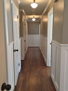 Paint Hallway if you paint one side of the hallway a different, darker color