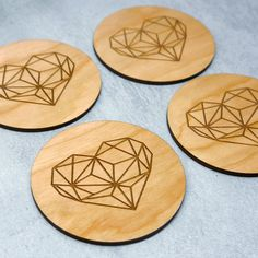 A set of 4 beautiful wooden coasters laser etched with a geometric heart design.   These wooden coasters are carefully handmade for you in our Brighton studio. The wooden coasters are laser cut from cherry wood veneer from sustainable sources, and the geometric heart is laser etched onto the surface.   These coasters would make a great addition to your coffee table and are the perfect housewarming or wedding gift for a loved one.   These coasters come beautifully gift wrapped in a gift box…