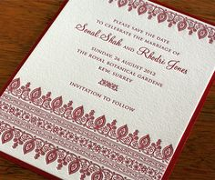 Red and gold Indian wedding invitations.