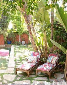 There was not one tree, and no pool, when the owners bought the California house decorated by Kathryn M. Ireland. They created this oasis. Restoration Hardware chaises with cushions in Kathryn Ireland fabrics.