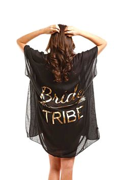 """This cover-up is the perfect accessory for beach bridal photoshoots! This cover-up is available in black or white, and features the words """"Bride Tribe"""" in a fun script. This cover-up runs as a one size fits most. This cover-up measures X Black Swimsuit, Swimsuit Cover, Bachelorette Gifts, Bachelorette Cruise, Summer Kimono, Bride Gifts, Mother Of The Bride, Swimsuits, Bride And Bridesmaid Shirts"""