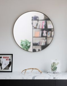 Umbra Hubba Wall Mirror | Shop Modern Round Mirrors Large Round Wall Mirror, Round Mirrors, Mirror Shop, Modern Frames, Bathroom Wall Decor, Bathroom Mirrors, Wall Mounted Mirror, Wall Hooks, Frames On Wall