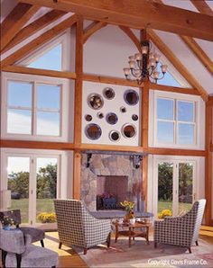 Timber frame great room with modern and vintage decor. By Davis Frame Co.