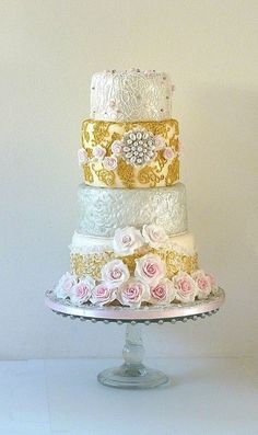Fashion inspired wedding cake (beautiful bracelet Billib I found online and Dolce and Gabbana 2012/2013 winter season dress - second photo). Covered with fondant, decorations fondant and gumpaste, sugar pearls. Non edible brooch (still didnt find time to make a silicone mold...). Roses fondant.