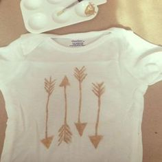 Such a great idea for a baby shower - I stead of cheesy games - but some white onesies and have everyone paint them different designs!! by wendi