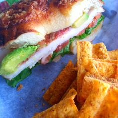 Einstein's Turkey Bat: asiago bagel, turkey, lettuce, tomato, avocado, bacon with a red pepper cream cheese. Sun chips on the side :) yummy in my tummy!
