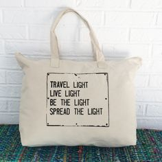 Travel Light Live Light Be the Light Spread the Light Cotton carry all bag. Perfect for yoga / workout gear, groceries / farmers market, and roomy enough to use as a weekend getaway bag. SIZE: Size: 2