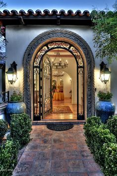 Love this entry door the details around the door framing adds to the elegance .