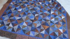 """Blue and Brown HST, using 5"""" squares.  (Laila Nelson)"""
