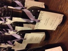 Love Meghan's favors.  Red wine with custom labels and the escort card hanging by a lavender ribbon- Beautiful!