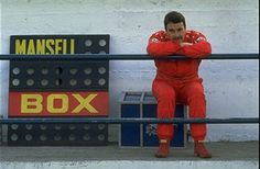 Scuderia Ferrari driver Nigell Mansell of Great Britain relaxes during the Formula One testing at the Estoril circuit in Portugal. \ Mandatory Credit: Pascal Rondeau/Allsport