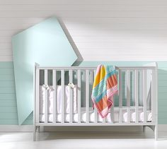 Nursery room set photography shoot for Mothercare with a grey cot in a modern light bedroom with white and mint wood cladding and matching white floorboards. Set build by our in house carpenter, Tom. Modern Bedroom Lighting, Light Bedroom, Chandelier Bedroom, Grey Cot, White Floorboards, Studio Rental, Wood Cladding, Gloomy Day, Video Studio