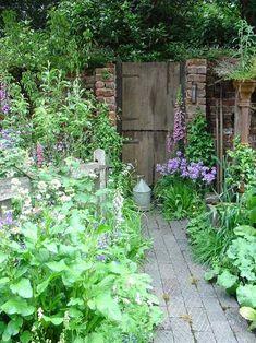 Landscaping can do wonders to the look of your home's exterior. The Secret Garden, Garden Doors, Garden Gate, Garden Cottage, Cottage Door, English Country Gardens, Exterior, Garden Spaces, Dream Garden