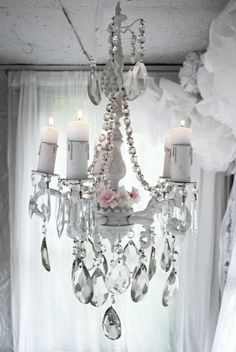 I love the oversized festoons creating such a charming look.  This particular chandelier would be just perfect in a lady's walk-in closet.