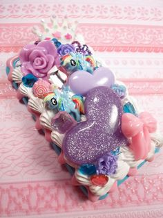 If only I had an IPhone...I love this!  Purple Princess My Little Pony Decoden Deco Case by Lucifurious, $42.00