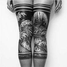 Black leg tattoo