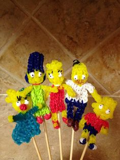 Rainbow Loom SIMPSON FAMILY (Maggie, Marge, Homer, Lisa &Bart). Designed and loomed by Cheryl Spinelli.