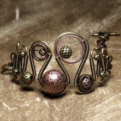 Wire wrapped bracelet by SuzyRea