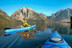 Kayak on Jackson Lake in Wyoming's Grand Tetons. Enjoy exclusive access and stunning mountain views on this fully guided weekend getaway.