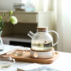 💛1L1.8L Large Capacity Drinkware Glass Teapot Teaware Tea Pot Heat-Resistant Kettle Wooden Lid Home Office Coffee Bar Supplier💛. Name: Glass Teapot Material: Borosilicate Glass Teapot+Oak Lid Capacity: 1000ML/1800ML Color: Transparent Feature -Made Of Borosilicate Heat-resistant Glass, It Can Bear Cold And Hot Water At The Same Time -Handmade And Can Resist The Temperature From -30oC-150oC -Directly On Electric Ceramic Stove For Boiling Drinking Water -Oak Lid With Seal Ring. The Lid Will Not Tea Light Candles, Tea Lights, Ceramic Stove Top, Glass Teapot, Heat Resistant Glass, Afternoon Tea Parties, Tea Pot Set, Kitchen Items, Fixer Upper