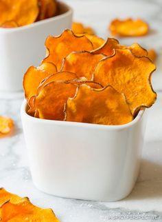 Baked Sweet Potato Chips Recipe - This simple 3-ingredient recipe makes a fabulous healthy snack and side dish. Thinly sliced fresh sweet potatoes baked to