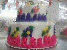 2 tier bday cake ( the picture is blurry because I didn't realize I have frosting on the camera til after I boxed up the cake ;p )