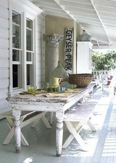 al fresco dining, lovely shabby old white table, cladding beadboard house, vintage style light and white!