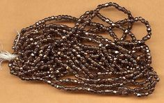 vintage seed beads hex cut bronze color beads on original hank, 16 per inch OVER 800 beads, they look like metal but they are glass by beadtopiavintage on Etsy