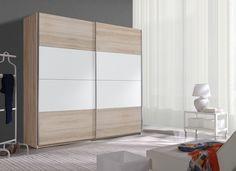 Šatníková skriňa BETKA ponúka množstvo úložného priestoru. V spojení s jej elegantným a moderným dizajnom sa stane neoddeliteľnou súčasťou vašej domácnosti. Posuvné dvere umožňujú ešte lepšie využitie priestoru a dobrú manipuláciu s nábytkom. #byvanie #domov #nabytok #skrine #skrinespojazdom #modernynabytok #designfurniture #furniture #nabytokabyvanie #nabytokshop #nabytokainterier #byvaniesnov #byvajsnami #domovvashozivota #dizajn #interier #inspiracia #living #design #interiordesign White Wardrobe, Wardrobe Closet, Fresh To Go, Wardrobe Design, Wardrobes, Baltimore, House Plans, Interior, Furniture